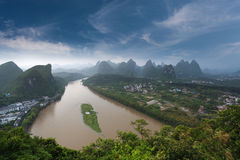 Lijiang river in yangshuo. Overlooking the karst landform and the lijiang river after the rain at green lotus mountain peak in yangshuo,China Royalty Free Stock Images