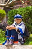 Lijiang Traditional Dressed Naxi Woman Sitting Royalty Free Stock Photos