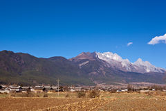Lijiang yulong Jokul and Village Royalty Free Stock Images