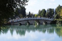 A bridge in the Black Dragon Pool in Jade Spring Park, Lijiang, Yunnan, China royalty free stock photo