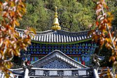 Decorated facade of a temple in the Chinese gardens of the Black Dragon Pool in Jade Spring Park, Lijiang, Yunnan, China royalty free stock photography