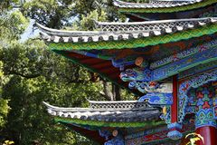 Decorated facade of a temple in the Chinese gardens of the Black Dragon Pool in Jade Spring Park, Lijiang, Yunnan, China stock photography