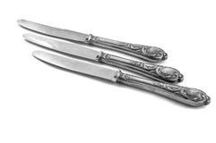 Lijst drie knifes aangaande witte achtergrond Stock Afbeeldingen