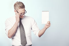 Likable businessman looking at empty notebook. Royalty Free Stock Images