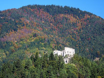 Likava castle in deep forest, Slovakia. View of ruined Likava castle hidden in deep forests in autumn. This castle ruin is wide known because it is believed that stock image