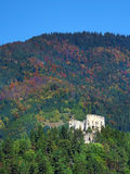Likava Castle ruin hidden in deep forest. View of Likava Castle ruin surrounded by deep forests in autumn. This castle ruin is wide known because it is believed stock images
