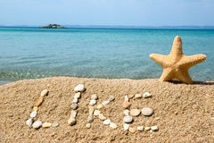 Like. Sign made of rocks on the beach Royalty Free Stock Photos
