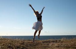 Like a bird. Pretty blond jumping Royalty Free Stock Photo