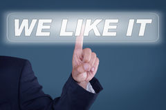 We like it. Businessman pushing button for we like it Stock Photos