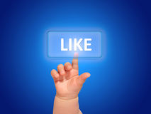 Like button. Hand pressing like button over blue background royalty free stock photo