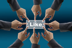 Like button teamwork. Team of businessman push on like button for teamwork concept royalty free stock photos