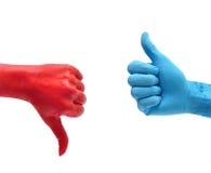 Like dislike. Dislike red hand and like blue hand over white royalty free stock image