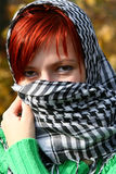 Like eastern woman. Portrait of woman with red hair and scarf like eastern Royalty Free Stock Photo