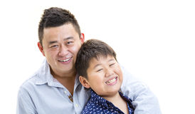 Like Father like son. A father holding son for a portray shot on a isolated white background Royalty Free Stock Photo
