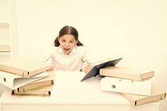 Like a fury. Angry pupil clenched her hands into fists. Little girl dont like reading lesson book in school. Small child royalty free stock photography