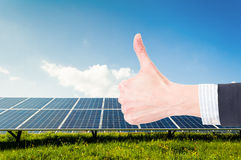 Like gesture on power plant or photovoltaic field background Stock Image