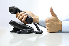 Like hand with office phone on desk Royalty Free Stock Photography