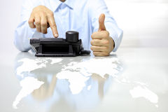 Like hand with phone and map on desk, call center concept Stock Photography