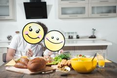 Joyful dad and child eating together in kitchen stock images