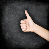 Like - Likes hand giving thumbs up on blackboard royalty free stock images