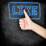 Like - likes thumbs up on blackboard. LIKE written on chalkboard with hand giving thumbs up hand sign Stock Photography