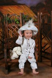 Like the little prince baby and soft toy dog Royalty Free Stock Photo