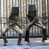 Like Michael Jackson. AURILLAC, FRANCE - AUGUST 23: Two dancers, with a bucket on the head, move as Michael Jackson, Aurillac International Street Theater Stock Photo