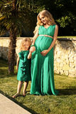 Like mother like daughter. beautiful pregnant woman with her child Royalty Free Stock Image