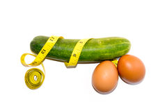 Like Penis - Cucumber eggs with yellow tape isolate on white Royalty Free Stock Photography