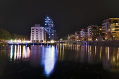 Like a rampant horse. Strasbourg at night with Goliath cranes near river Stock Photos