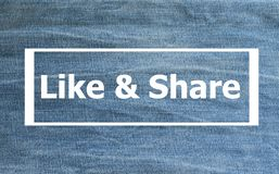 Like & Share words. `Like & Share` on blurred jeans background Stock Photography