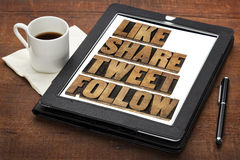 Like, share, tweet and follow. Like, share, tweet, follow words - social media concept - isolated text in vintage letterpress wood type on a digital tablet with stock photography