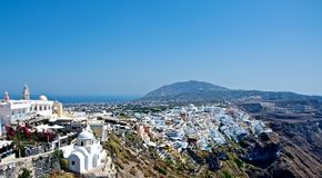 Like snow on top. Like snow on top of a mountain of Santorini, situated white city. This man-made miracle every year attracts thousands of tourists Stock Images