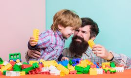 We like spending time together. small boy with dad playing together. happy family leisure. building with constructor stock images