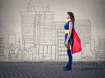 Like a superwoman. A girl is dressed like a superwoman Royalty Free Stock Images