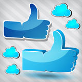 Like symbols with blue clouds Stock Photography