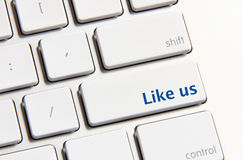 Like us button. Photo of like us button on the white keyboard stock photo