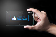 Like us on Facebook icon. Johor, Malaysia -Transparent smartphone, like us on Facebook icon with dark background. Facebook is largest social networking website stock illustration