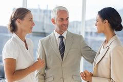 Likeable businessman speaking with female colleagues Royalty Free Stock Images