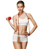 Likeable fit girl with red dumbbell and skipping rope, jumping-rope Stock Photography
