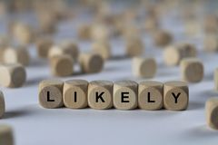Likely - cube with letters, sign with wooden cubes Stock Images