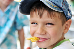 He likes fries Stock Images