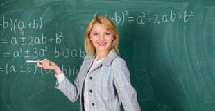 She likes her job. Back to school concept. Working conditions which prospective teachers must consider. Woman smiling. Educator classroom chalkboard background stock photos
