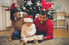 He likes to read fairy tales with his family stock photo