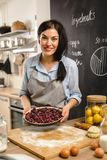She likes to spend time preparing sweet pie stock photo