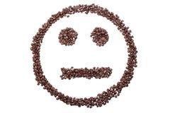 Likgiltig smiley från kaffebönor som isoleras på vit bakgrund Royaltyfria Bilder