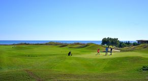 Golf players are enjoying Likya Links Golf course at sunny day in  Antalya royalty free stock images