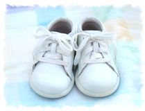 Lil'baby two shoes. Old baby shoes Royalty Free Stock Images