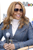 Lil Kim appearing. Lil Kim announcing her partnership to help save our nation's fine foster kids through her partnership with Children Uniting Nations royalty free stock image