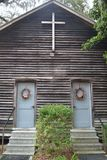 Lil' Ol' Country Church - Front Doors. This old country church has Christmas Wreaths on the front doors Royalty Free Stock Photos